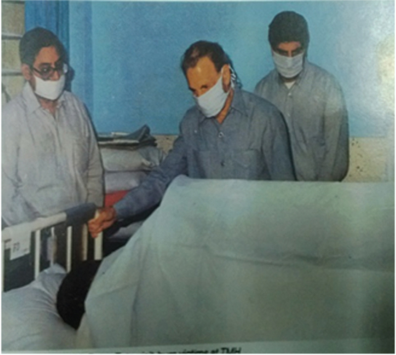 Figure 1: File picture of J R D Tata visiting victims of burn disaster in 1989
